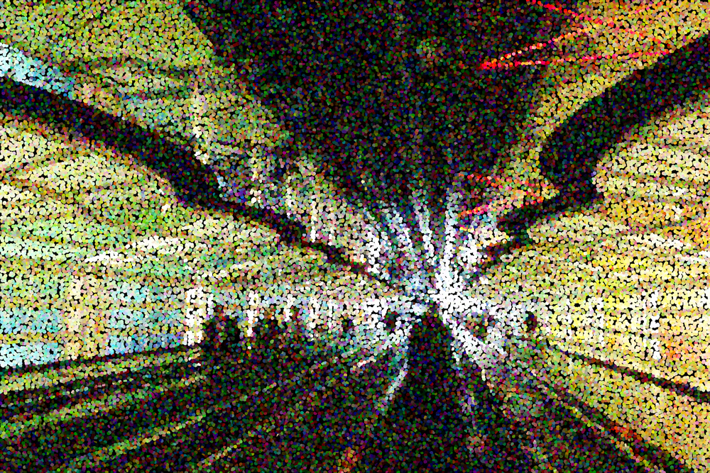Multicolored pointillist abstract of passageway with neon lights and moving walkway on approach to concourses at a large metropolitan airport